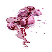 Crushed eye shadow, lipstick and nail polish — Stock Photo