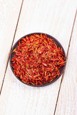 Saffron in bowl — Stock Photo