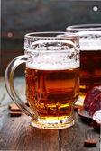 Beer with salami — Stock Photo