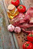 Steaks with tomatoes — Stock Photo