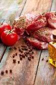 Steaks with tomatoes and oil — Stock Photo