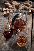 Cognac with pipe smoking — Stock Photo