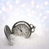 Watch lying in the snow — Stock Photo