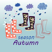 Autumn background with rubber boots — Stock Vector