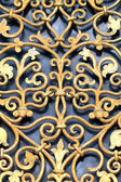 Wrought-iron lattice pattern on the window — Stock Photo