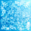 Bright winter background with snowflakes — Stock Photo