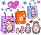 Shopping bags with the Russian nest-dolls, by colors and hearts — Stock Photo