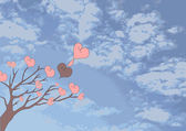 Tree with hearts against the cloudy sky — Stock Photo