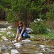 Happy, cheerful girl squirting water from the creek and laughs — Stock Video