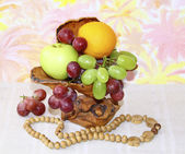 Exclusive wooden vase with apples, grapes and oranges on abstrac — Stock Photo