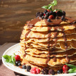 Pancakes with chocolate syrup and berrie fruits — Stock Photo #12354939