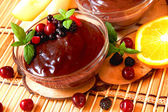 Chocolate pudding with berries and mint — Stock Photo