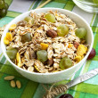 Breakfast with musli and grapes — Stock Photo