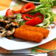 Fish fingers and salad — Stock Photo