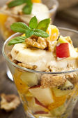 Fruit salad with nuts and mint — Stock Photo