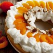 Stock Photo: Apricot Tart with Whipped Cream and Flaked Almonds