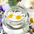 Stock Photo: Camomile flowers essence for spa