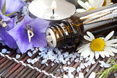 Essence bottle and spa flowers — Stock Photo
