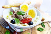 Salad with tuna and boiled eggs — Stock Photo