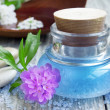 Spa essence bottle, flowers and sea salt — Stock Photo