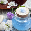 Spa essence bottle, flowers and sea salt — Stock Photo #28619865