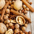 Nuts and Spices on Wooden Background — Stock Photo