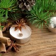Holiday decoration with candle,fir and cinnamon on wooden backgr — Stock Photo #34828423