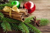 Cinnamon sticks on festive celebration background — Stock Photo