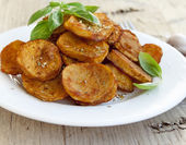 Spicy baked potatoes — Stock Photo