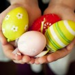 Hands Holding Colorful Easter Eggs — Stock Photo