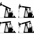 Foto Stock: Oil well pump jack silhouette