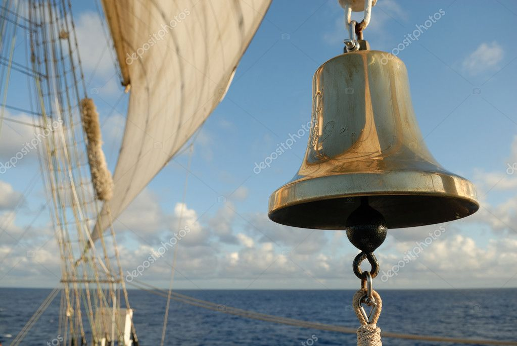 Marine bell and sails on the ocean background  Stock Photo #13482485