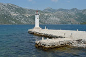 Lighthouse onGospa Od Skprjela and islands Montenegro — Stock Photo