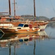 Old wooden sailing ship in the sea bay — Stock Photo