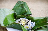 Thai dessert in banana leaves — Stock Photo
