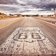 An old Route 66 shield painted on road — Stock Photo #13863344