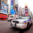 Stock Photo: Empty Times Square with NYPD car