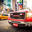 FDNY car and taxi car on Times Square - Stock Photo