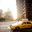 Yellow taxi cab in New York City - Stock Photo