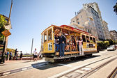 Passengers enjoy a ride in a cable car in San Francisco. — Stock Photo