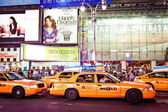 Taxi cabs riding through Times Square — Stock Photo
