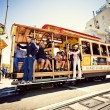 Passengers enjoy a ride in a cable car  in San Francisco — Stock Photo