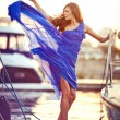 Attractive girl dancing in fluttering blue dress — Stock Photo