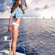 Attractive girl on a yacht at summer day - Stok fotoğraf