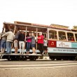 Passengers enjoy a ride in a cable car  — Stock Photo