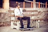 Man with skateboard in Santa Monica — Stock Photo