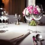 Empty glasses set in restaurant — Stock Photo #26251601