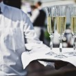 Waiter serving champagne — Stock Photo