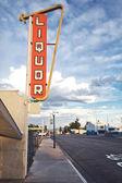 Old liquor store sign — Stock Photo