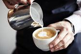 Barman making coffee — Stock Photo